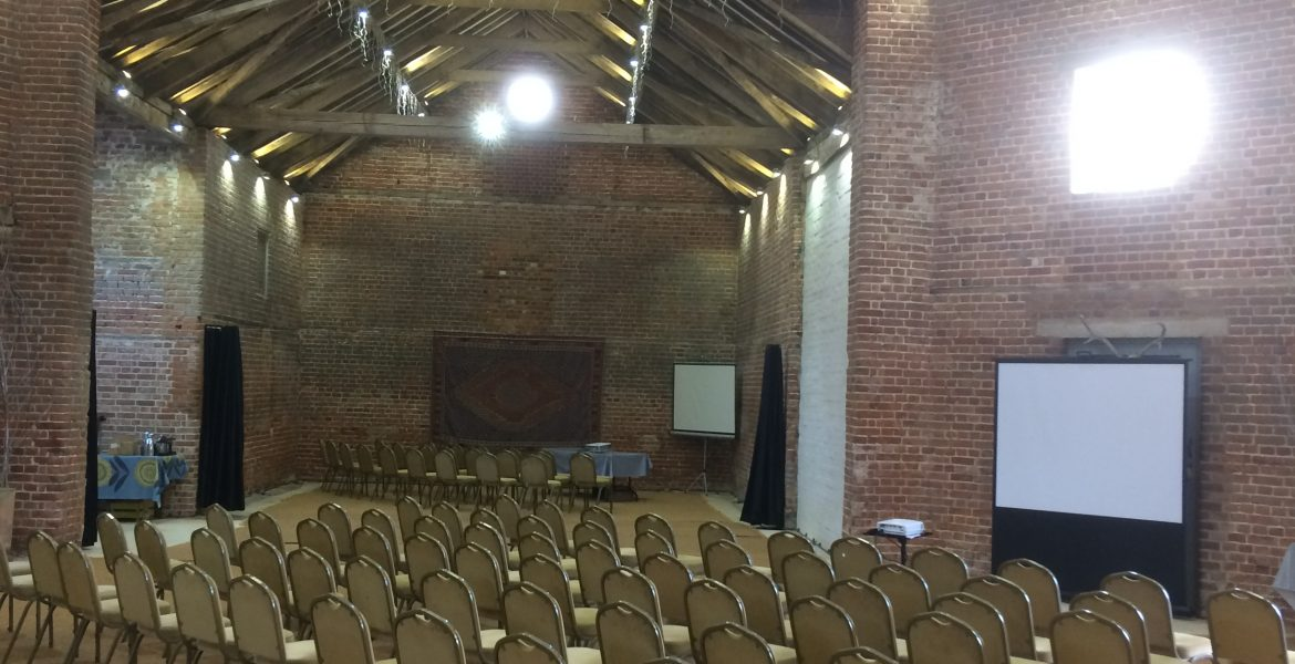 Setting up for business conference at The Octagon Barn